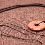 COAI® Collier avec Pendentif Donut Rond Pierre de Protection Cordon Réglable Design Unique Unisexe de la marque coai image 1 produit